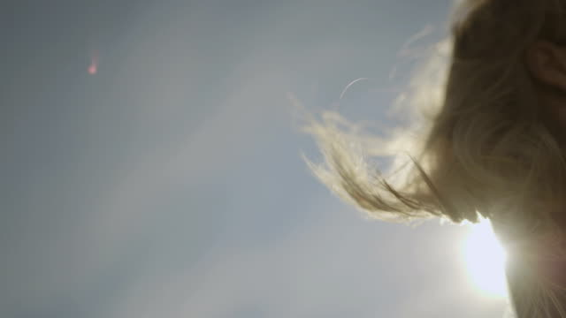 women's hairs waving in the wind