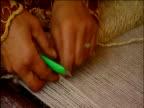 Women's hands weaving Persian carpets from balls of wool Shiraz