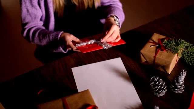 Women's Hands Wrapping Christmas Gifts At Home