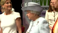 Women's Institute members applauding as Queen Elizabeth II enters Royal Albert Hall along with Anne Princess Royal and Sophie Countess of Wessex The...