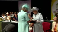 Women's Institute members present Queen Elizabeth II with the Centenary Women's Institute 'baton' The Queen presses a button to start a presentation...