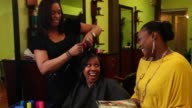 MS Women's socializing at  beauty parlor / Irvington, New Jersey, United States
