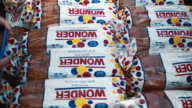 Wonder bread is some of the items given to people for their Holiday Food Baskets outside the Little Havana offices of CAMACOL the Latin American...