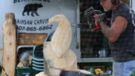 A wood based artisan working on an eagle sculpture at the Delaware County Fair