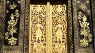 MS Wood carved door with ornaments at Wat Xieng Thong Temple  AUDIO / Luang Prabang, Luang Prabang, Laos