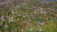 WS AERIAL ZI Wooded area with autumn colors and Wethersfield town nesting in trees / Connecticut, United States