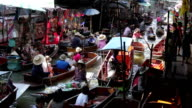 Wooden boats busy ferrying people at Damnoen Saduak Floating Market