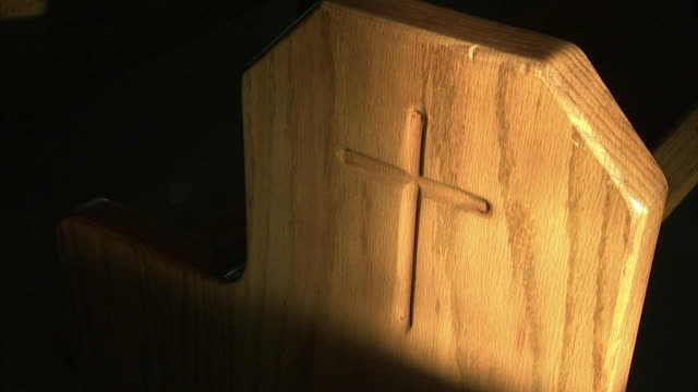Wooden church pew end panel w/ simple etched Christian cross Religion religious house of worship prison not jail correctional facility