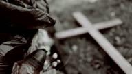 Wooden cross, graveyard dustbin