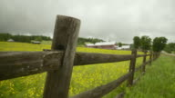 MS R/F Wooden fence in field, large barn in distance / Morristown, Vermont, USA