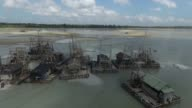 Wooden rafts used for dredging tin ore sit on the beach in this aerial video taken off the coast of Bangka Island in Indonesia on Thursday July 30...
