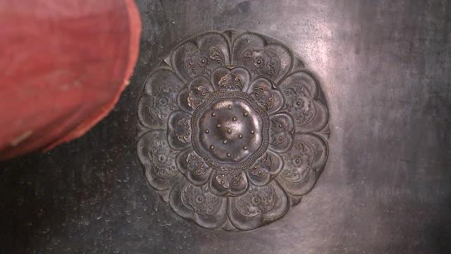 MS Wooden ram hitting ornate temple bell in tample / Hapchun, Gyeongsangnamdo, South Korea