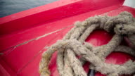 wooden ropes on top part of an old sailboat