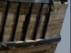 Wooden slats cover the outer hull of a vessel.