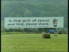 Woodstock 25 years on DAY LMS Hoarding 'In the spirit of peace and love please share' LMS Sign 'Dont look back 25 years ago is straight ahead' LA MS...