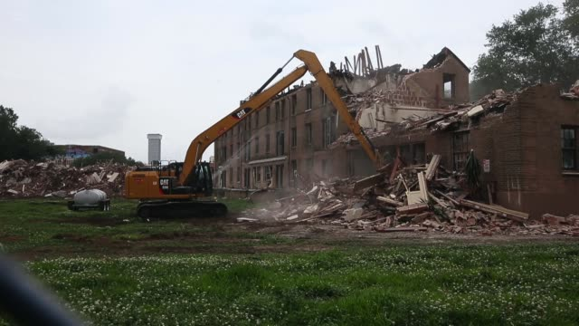 A work crew demolishes buildings at the BW Cooper housing projects on May 12 2015 in New Orleans Louisiana The projects were damaged by Hurricane...