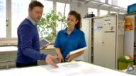 Worker and manager discussing at printing industry
