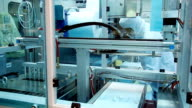 Worker at medical equipment production line