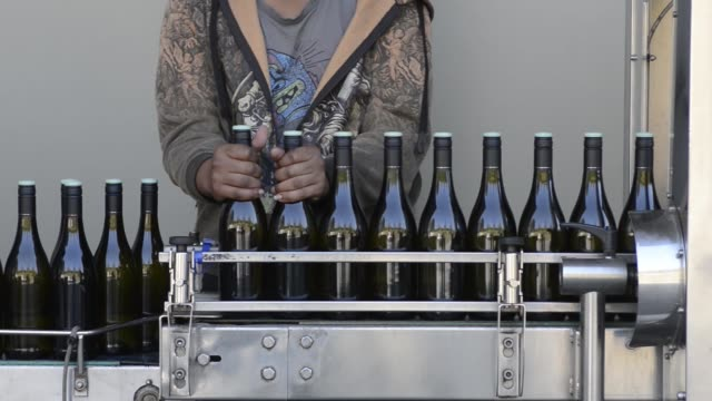 A worker bottles wine using a mobile bottling station in the yard at the Delaire Graff Estate in Stellenbosch South Africa on Thursday Aug 18 Bottles...