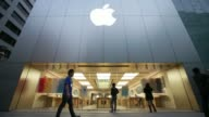 A worker cleans inside an Apple Inc store ahead of the launch of the company's iPad Air at dawn in the Ginza district of Tokyo Japan on Friday Nov 1...