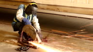 worker cutting steel.