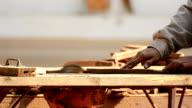 Worker Cutting Wood