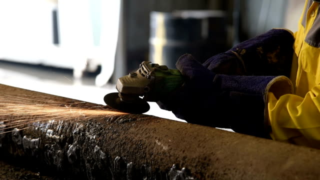 worker grinding in factory