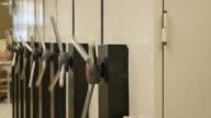 Worker open metal filing cabinets.