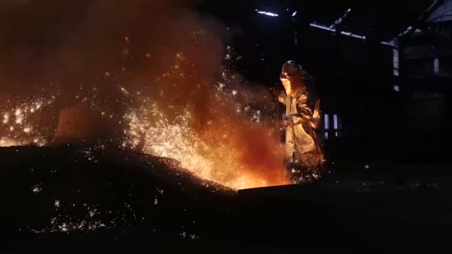 A worker operates in the blast furnace at ArcelorMittal's steel plant in Ostrava Czech Republic on Monday Aug 26 General views molten steel pours...