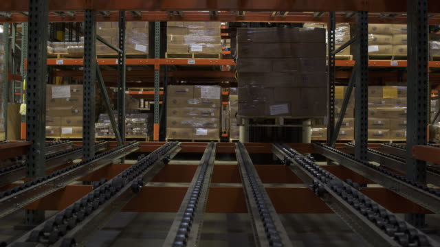 Worker operating a forklift in a warehouse