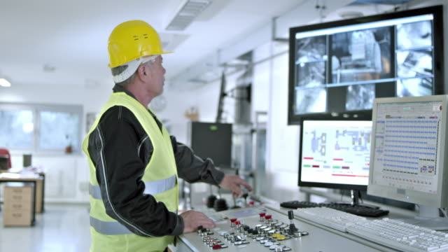 DS worker operating the recycling facility machines from control center