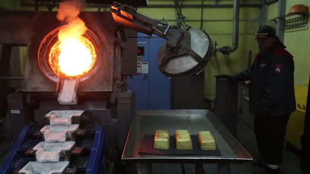 A worker pours molten gold into 25 kilogramm molds at the Verninsky GOK gold mine and processing plant operated by Polyus Gold International Ltd near...