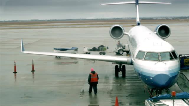 Worker preparing plane surroundings before departure