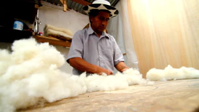 Worker separating wool in Saguro