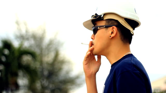 worker smoking while stress on break time