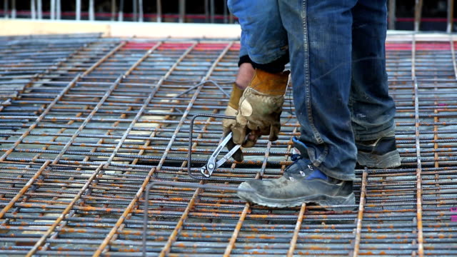 Worker Tying the Rebar on Constrution Site CU