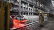A worker uses a crane to remove the lid from an electrolysis bath inside the electrolysis shop at the Krasnoyarsk aluminum smelter operated by United...