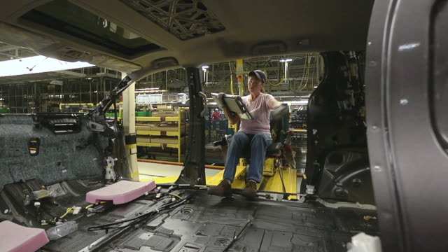 MS PAN Worker using an ergonomically designed sled to help her moving inside mini van / Princeton, Indiana, United States