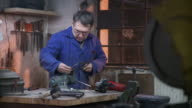HD DOLLY: Worker Using Iron Saw