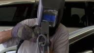 CU Worker welding metal piece / Cathedral City, California, USA