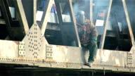 worker works with welder