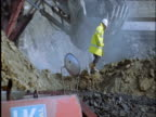 Workers and heavy machinery in coal mine UK