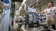 Workers assembles VW 16MPI petrol automobile engines on the assembly line at the Volkswagen Group Rus OOO plant in Kaluga Russia on Tuesday Sept 19...