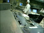 Workers at panels in control room Reactor 3 Chernobyl