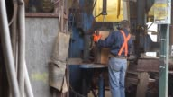 Workers at SW Forest Products Ltd split shave and process cedar logs into shakes and singles on Tuesday Feb 11 2014 in Maple Ridge British Columbia...