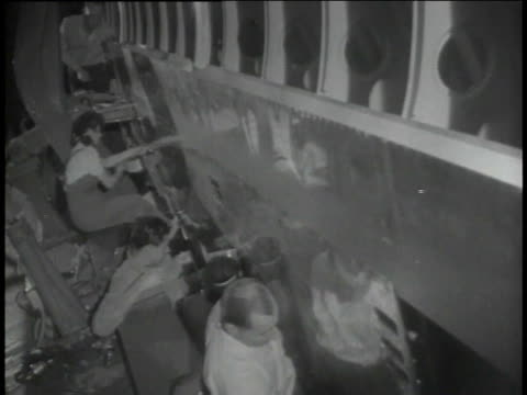 MONTAGE workers building planes in factory / United States