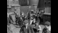1900 - Workers come through the gates at Bradley Shed