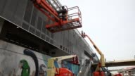 WS Workers construct a new facade on the train station outside the famed Maracana stadium site of the 2014 FIFA World Cup final on May 21 2014 in Rio...