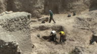 WS HA Workers digging at excavation site in Roman ruins, Alexandria, Egypt