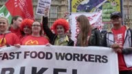 Workers have gathered to protest zero hours contracts and working conditions at McDonalds Many protesters have dressed as the iconic McDonald's clown...